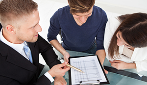 An agent helping a couple with bid bonds from United Surety Bonds